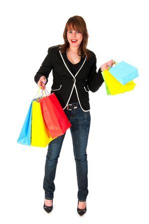 Mädchen ist aufregend von shopping mit vielen bunten Taschen