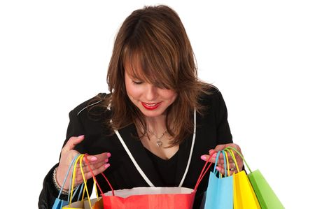 Girl is shopping and looking inside of her bags photo
