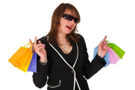 Girl is exciting by shopping with many colorful bags photo