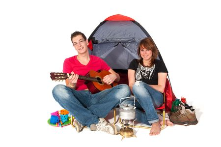 making music: couple in tent at campground isolated over white Stock Photo
