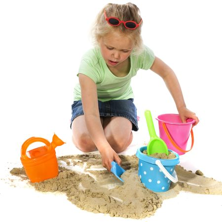 sandbox: Little blond girl is playing with sand Stock Photo