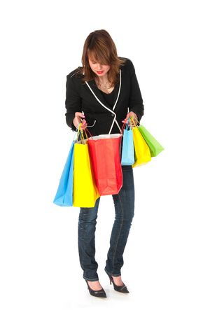 Young girl is looking inside of her shopping bags photo