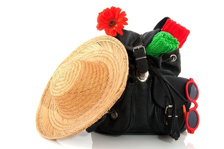 ruck sack: traveling by backpack with straw hat over white
