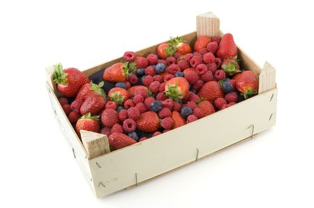 wooden crate with fresh mixed fruit on white background Stock Photo - 6767880