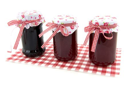 Glass pot with fruit jam isolated over white Stock Photo - 6787195