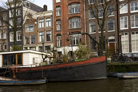Old boat in the canal in Amsterdam photo