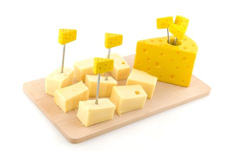 Cheese cubes on wooden tray isolated over white photo