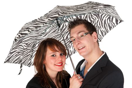 Young couple together under the black and white umbrella photo