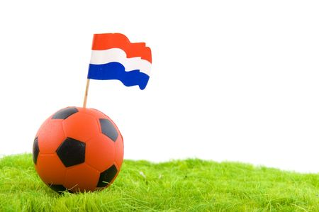 Dutch soccer with orange ball and flag in grass photo
