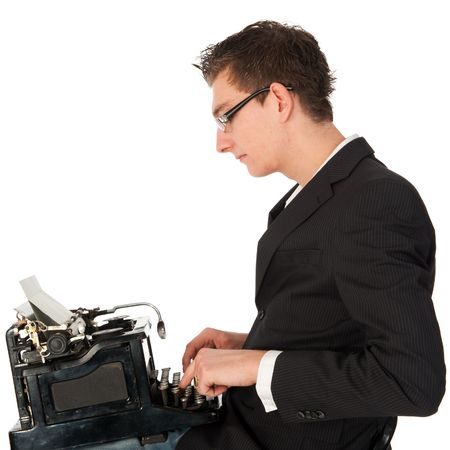 Young man is typing on the old antique black type writer photo