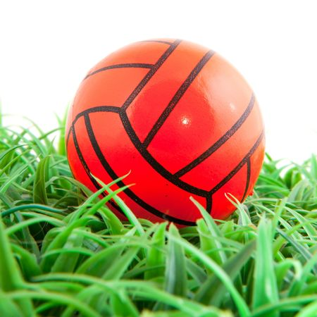 Orange soccer ball in the green grass photo