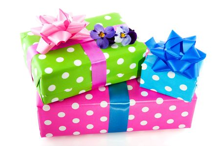 Colorful wrapped presents with ribbon dotted and stacked photo