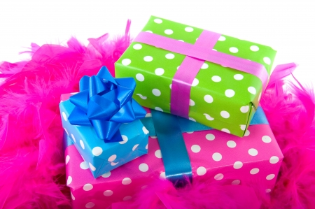 Colorful wrapped presents with ribbon dotted and stacked Stock Photo - 6816136