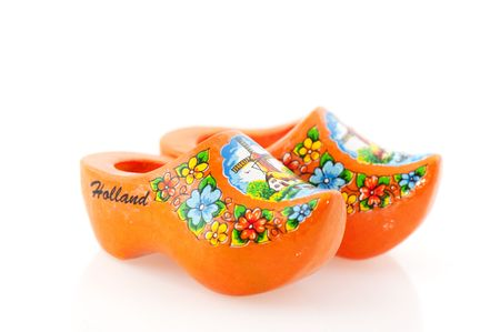 Orange Dutch clogs with Holland isolated over white photo