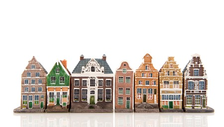 frontage: Amsterdam in miniature houses isolated over white
