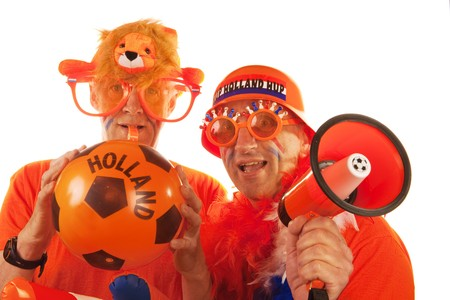 Dutch soccer fans dressed in orange with ball and megaphone photo