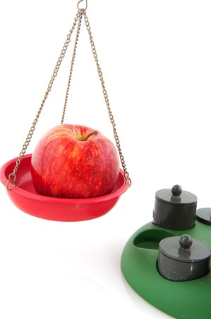 ove: Apple weight as concept for diet ove white Stock Photo