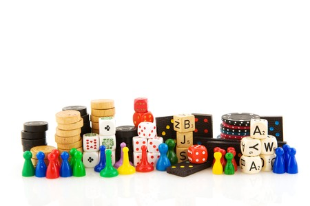 gambling stone: All attributes to play board games isolated over white Stock Photo