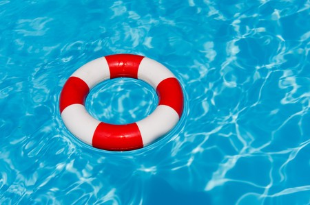 swimming pool with red and white life buoy photo