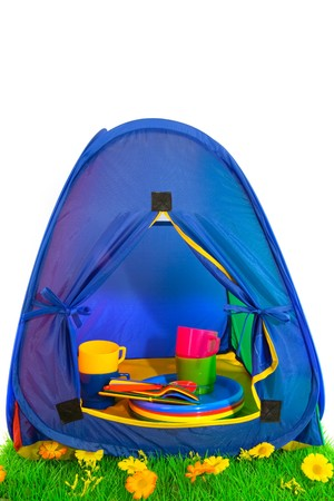campground: Blue tent at the campground with colorful plastic crocerky