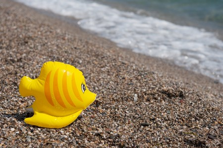 floatable: Plastic floatable fish at the summer beach Stock Photo