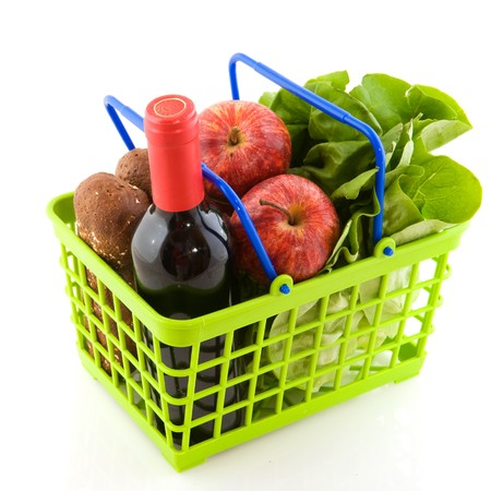vegetables supermarket: Green shopping basket with daily food isolated over white Stock Photo