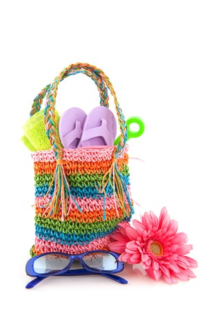 flops: colorful beach bag with toys and sunglasses for the whole family