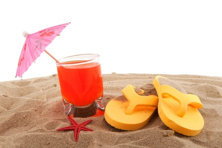 flops: Beach vacation with lemonade and flip flops in the sand