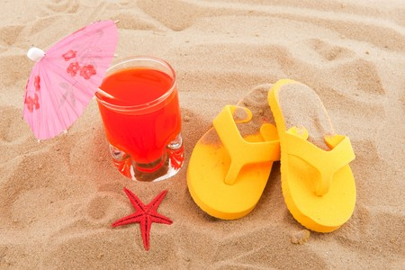 Beach vacation in summer with drink and flip flops photo