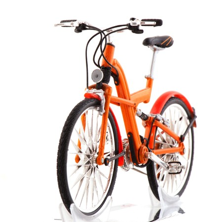 Orange bicycle in front isolated white background