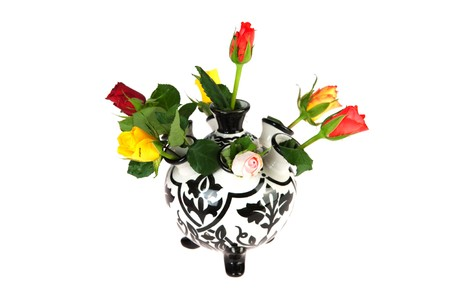 Colorful bouquet of roses in black and white tulip vase photo