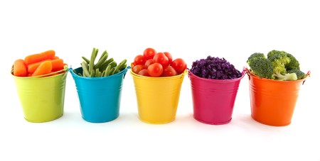 Little metal buckets with fresh vegetables on white background photo