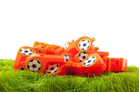 arbiter: many Dutch soccer whistles in green field