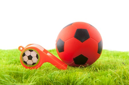 arbiter: Dutch whistle and soccer ball in the playing fields