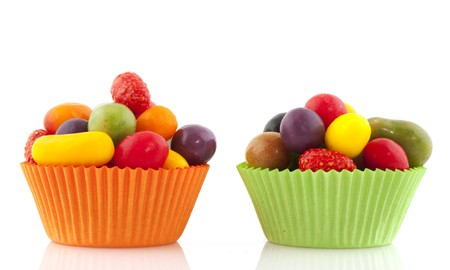 colorful candy in fruit shape with orange and green cup cake papers photo