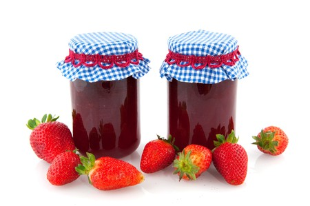 Homemade strawberry jam or marmalade in glass pots with fresh fruit photo