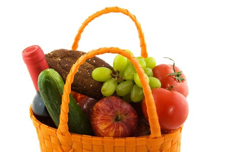 Orange shopping bag with daily food isolated over white photo