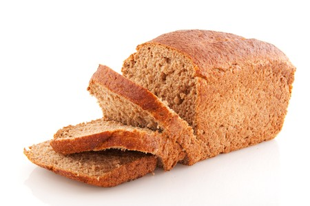 Brown sliced whole meal bread isolated over white photo