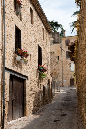 Little,French,France,lane,street,flowers,windows,rural,village,vertical,Europe,romantic,lantern Stock Photo - 7307172