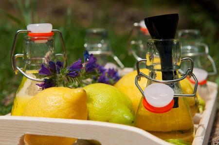 making home made lemon lemonade in little bottles photo