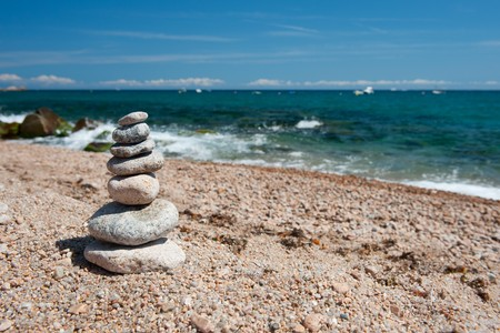 Landscape beach with stacked stones in balance photo