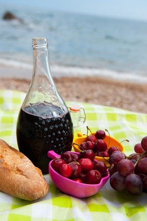 Wine bread and fruit at the picnic on the beach Stock Photo - 7306669