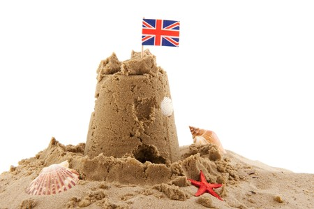 Beach with sand castle in England isolated over white photo