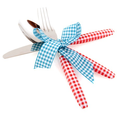 Checked red cutlery with blue checkered robbon