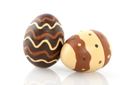 Chocolate easter eggs with decoration in dark and light