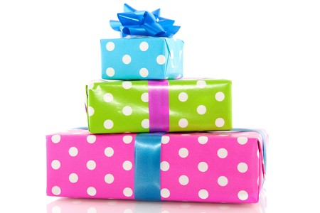 Pile colorful dotted presents with ribbons and bow Stock Photo