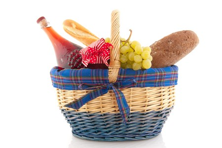 Cheerful cane basket with food for the picnic photo