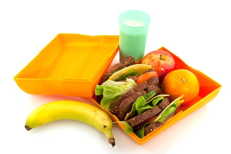 Healthy lunchbox with wholemeal bread milk and fruit photo