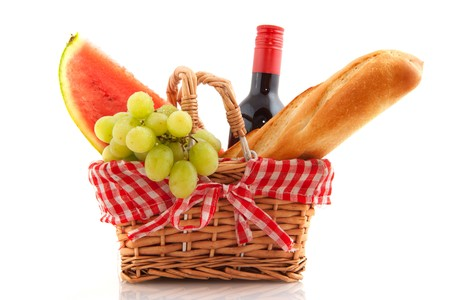 Picnic basket with bread wine grapes and water melon photo