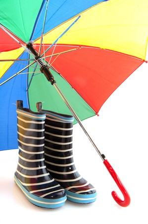 Blue and white striped rubber child boots with colorful umbrella against the rain Stock Photo - 7440105